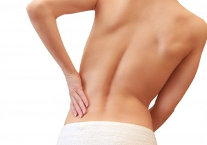 breast implants spine back pain